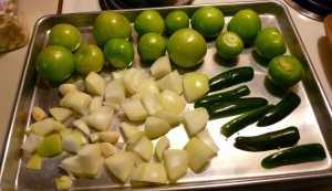 Tomatillos, Serranos, Onions and Garlic on a Baking Sheet