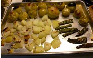 Broiled Tomatillos, Serranos, Onions and Garlic on a Baking Sheet