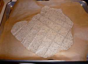 Dough and parchment paper on sheet pan