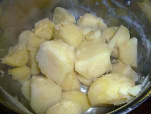Potatoes cooked fork tender and placed back in pot