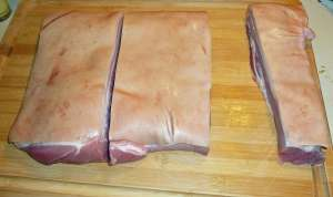Five pounds of boneless pork belly before the skin is removed