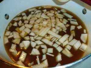Stock and onions in stock pot