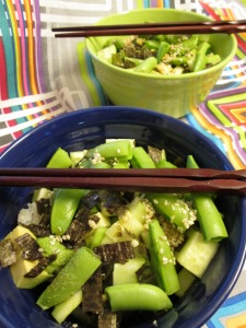 Vegan sushi rice bowl with just raw vegetables: cucumber, avocado, sugar snap peas