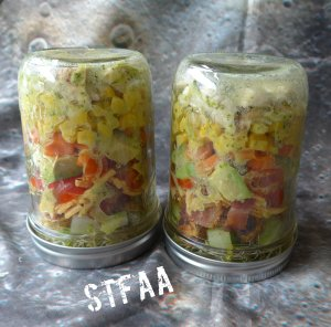 Jars flipped upside down to let the dressing mix in