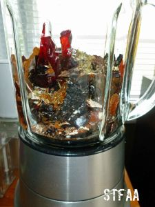 Dried chiles, cumin seed, garlic powder, oregano and paprika in blender
